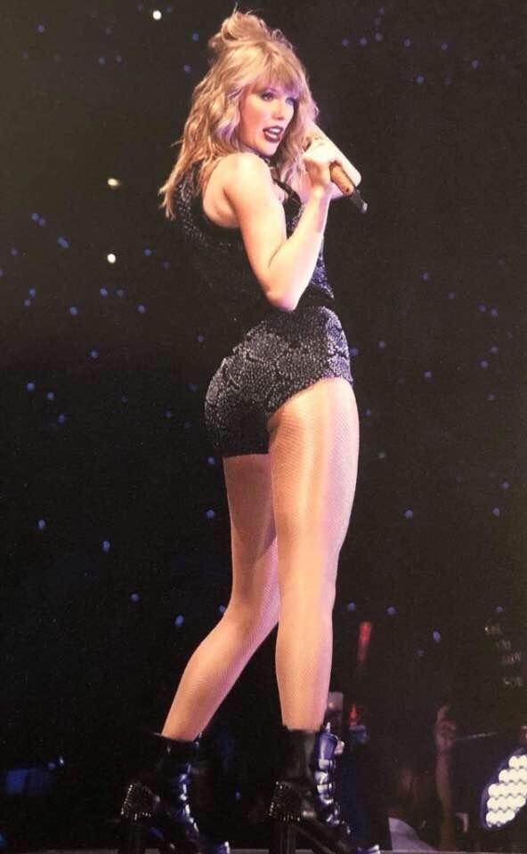 Girls, 1. Why are taylor swifts legs shiny in this pic?