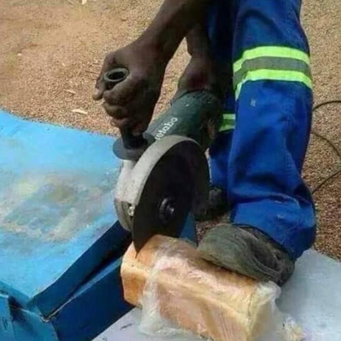 Is this person safely cutting their bread?
