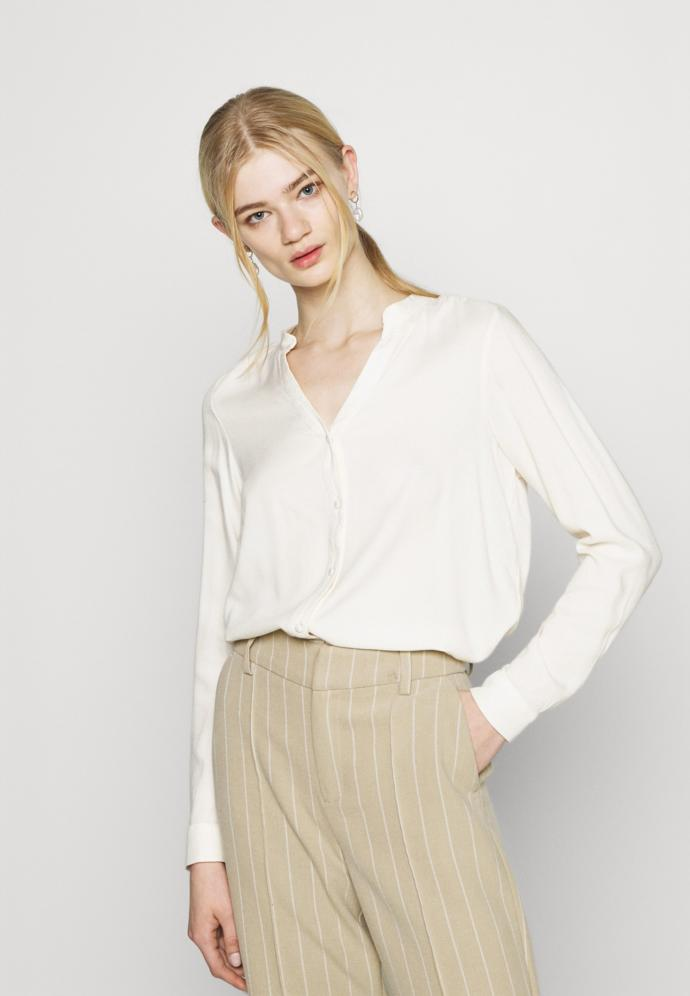 What do you think of the white button shirt style?