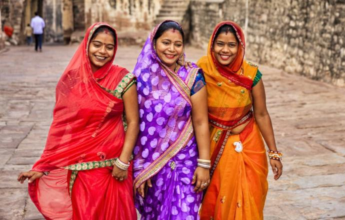 Why do Indian woman wear traditional clothing but other Asians dont?