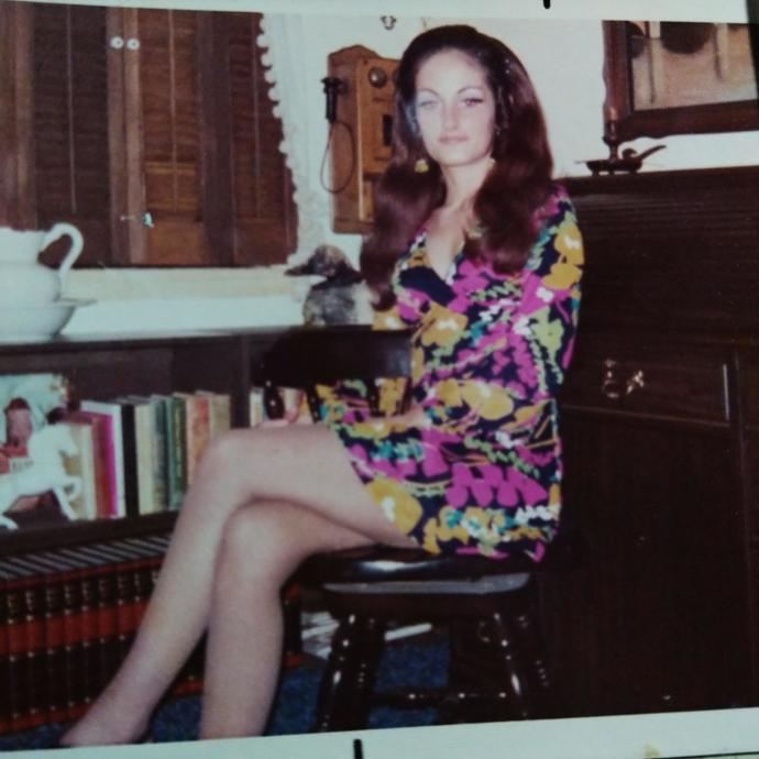 She was 27 here, photo taken in 2005. Pretty old house though. And the photo was on paper instead of digital.