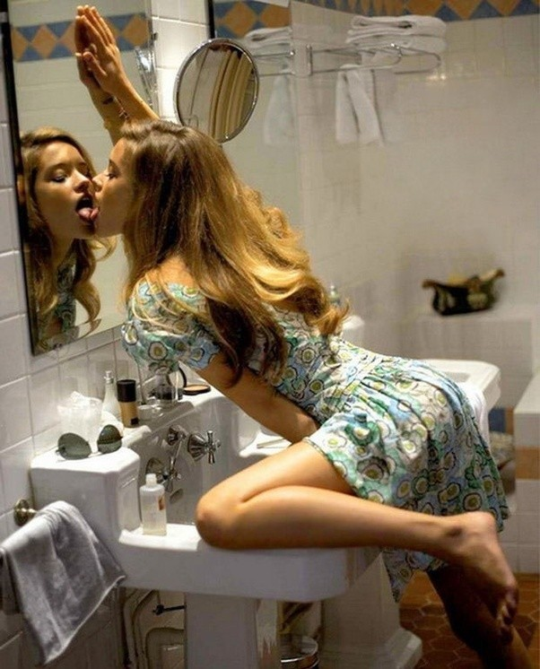 What is going on with this girl and the mirror?