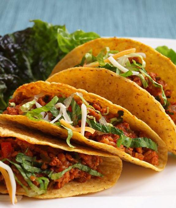 How do you eat hard shell tacos?