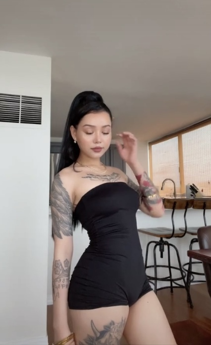 Guys, would you still date her regardless of the tattoos?