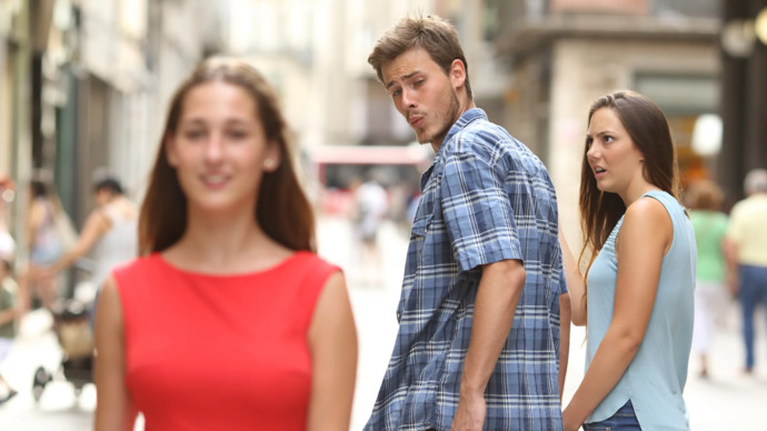Which girl do you think is hotter in the distracted boyfriend meme?