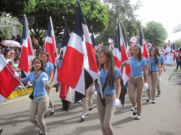 Dominican youth with Dominican flags