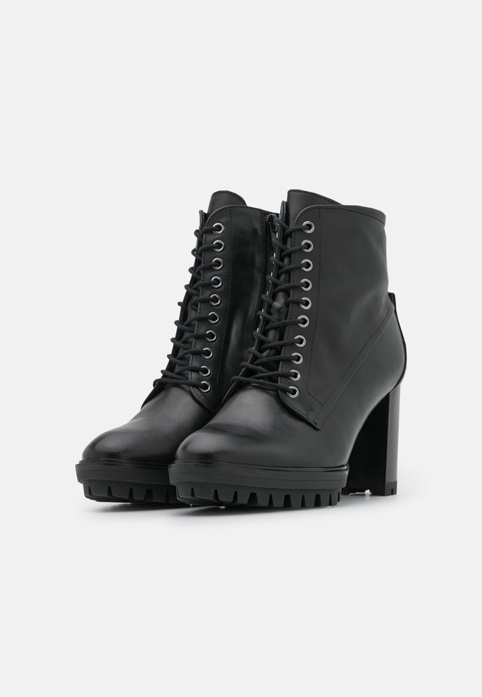 Which boots do you prefer - Elegant or Edgy?